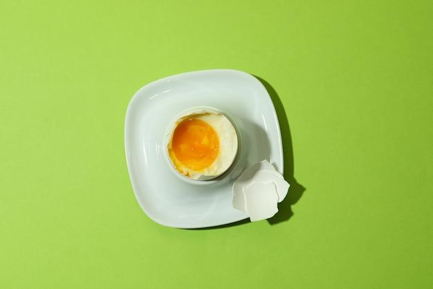 Tasty boiled egg on green