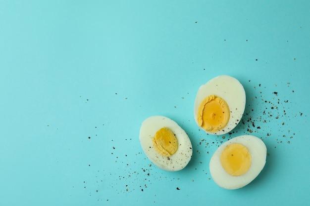 Tasty boiled eggs on blue