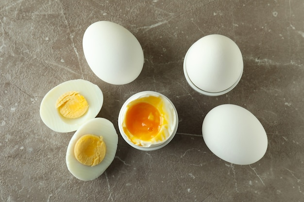 Tasty boiled eggs on gray textured table