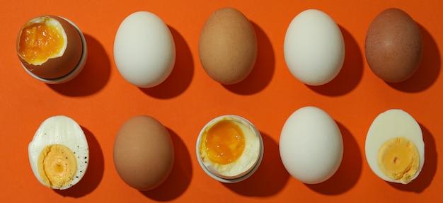 Tasty boiled eggs on orange