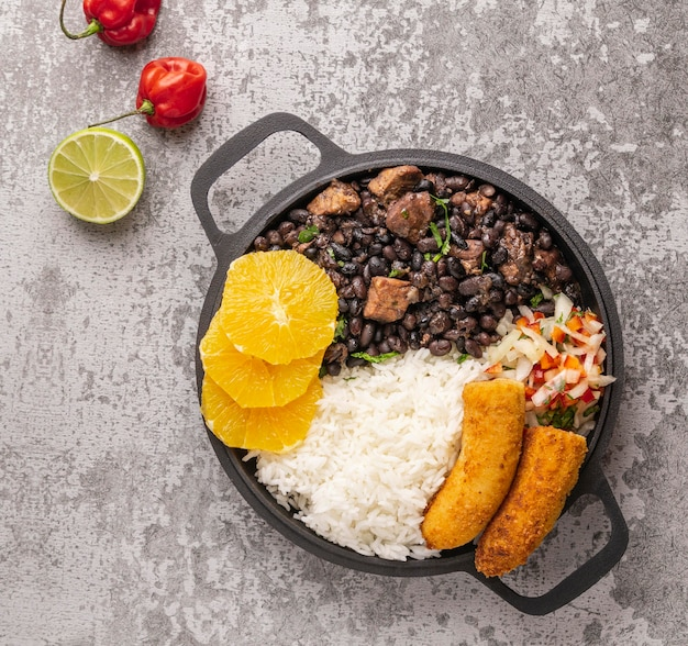 Tasty brazilian dish with orange top view