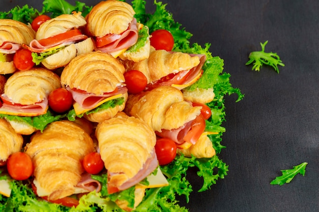 Tasty breakfast. appetizing croissant with salami cheese and tomatoes