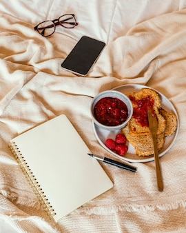 Tasty breakfast and notebook high angle
