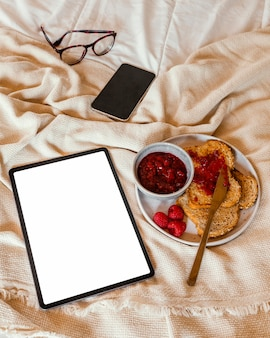 Tasty breakfast and tablet high angle