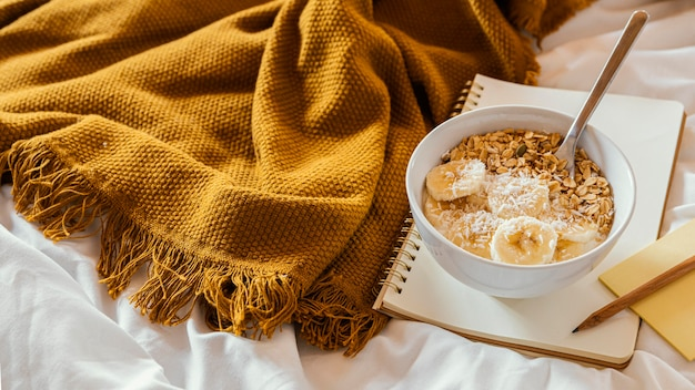 Tasty breakfast with cereals in bed