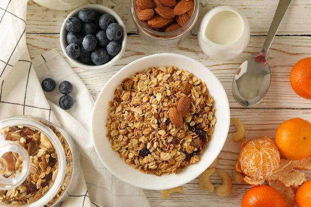 Tasty breakfast with granola on wooden table