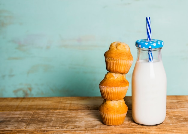 Tasty breakfast with milk and muffins