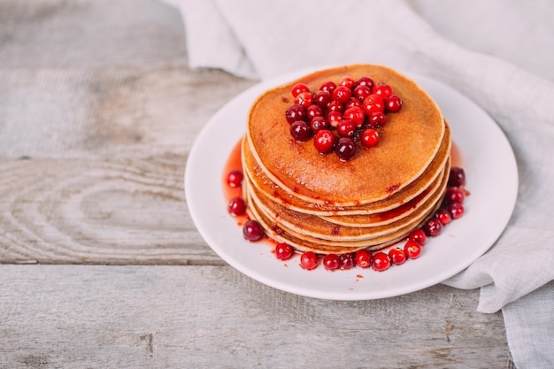 Tasty and bright pancakes with cranberries.