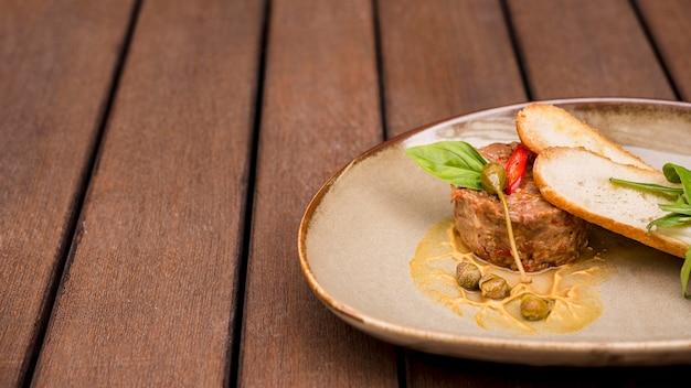 Tasty bruschetta and meatfront view