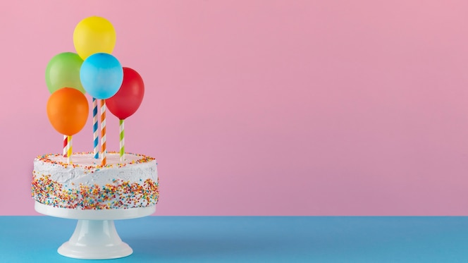 Tasty cake and colorful balloons