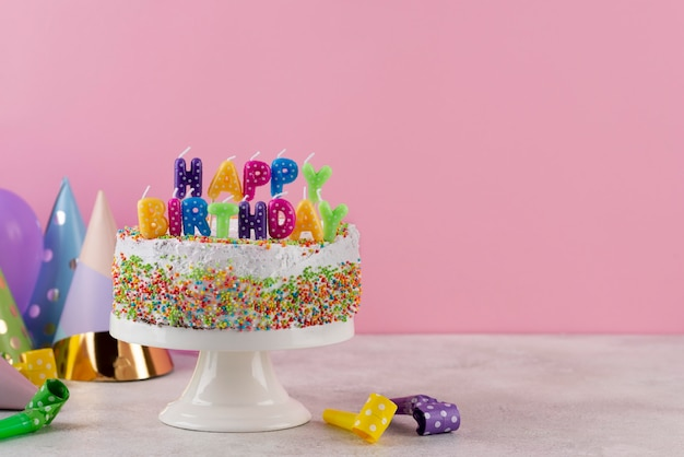 Tasty cake with birthday items