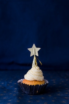 Tasty cake with butter cream and star