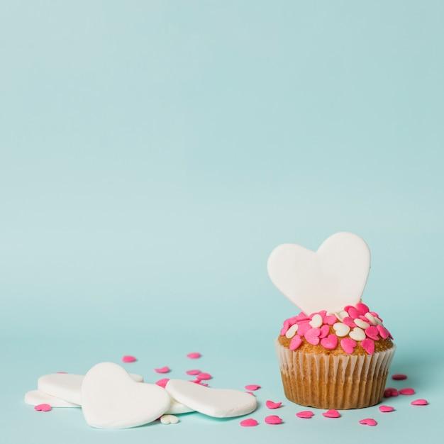 Tasty cake with decorative hearts