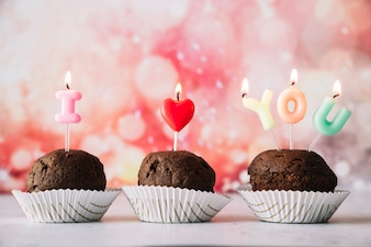 Tasty cakes with I love you title of burning candles on wands