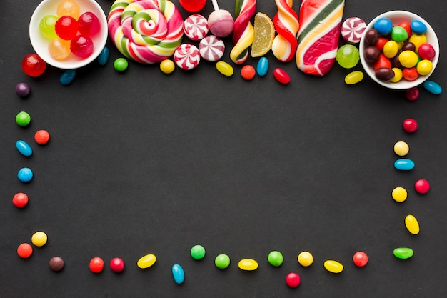 Tasty candies frame with copy space