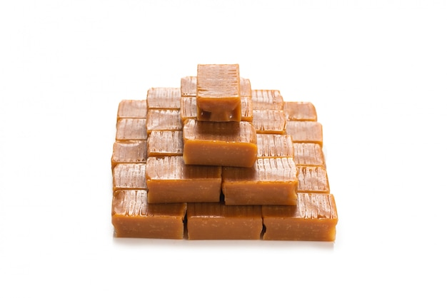 Tasty caramel candies isolated