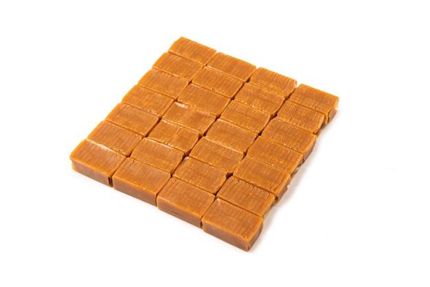 Tasty caramel candy isolated