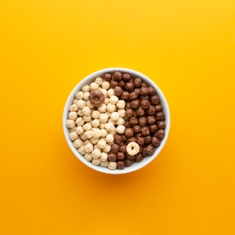 Tasty cereal bowl with flat lay