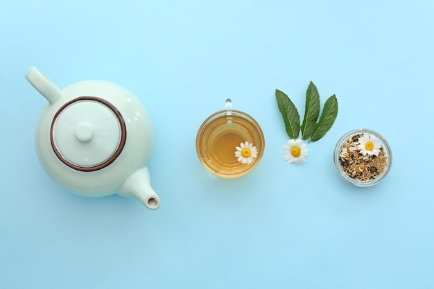 Tasty chamomile tea on table, top view