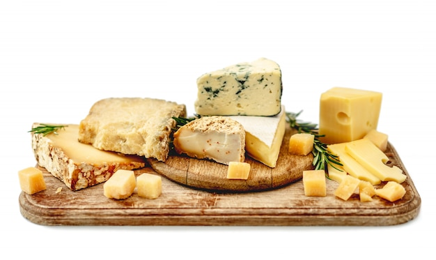 Tasty cheese plate with rosemary
