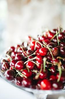 Tasty cherries lie on the plate