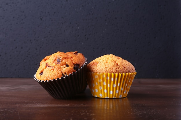 Tasty chocolate cupcakes, muffins on a white wooden table