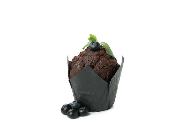 Tasty chocolate muffin isolated on white background.