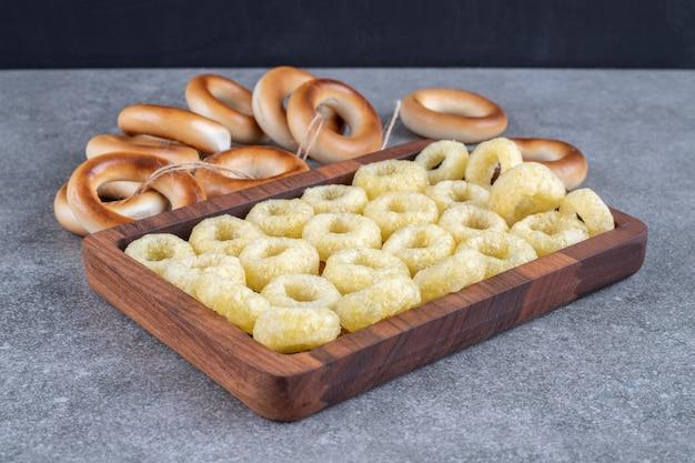 Tasty circle crackers on wooden platek