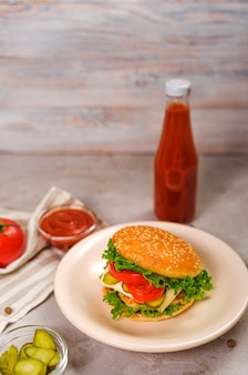 Tasty classic burger with cheese and ketchup