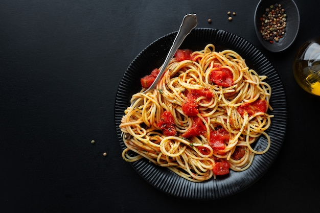 Tasty classic italian pasta with tomato sauce and cheese on plate. top view.