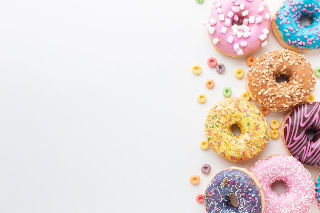 Tasty colorful donuts copy space