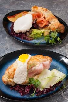 Вкусные круассаны с лососем и ветчиной concept breakfast