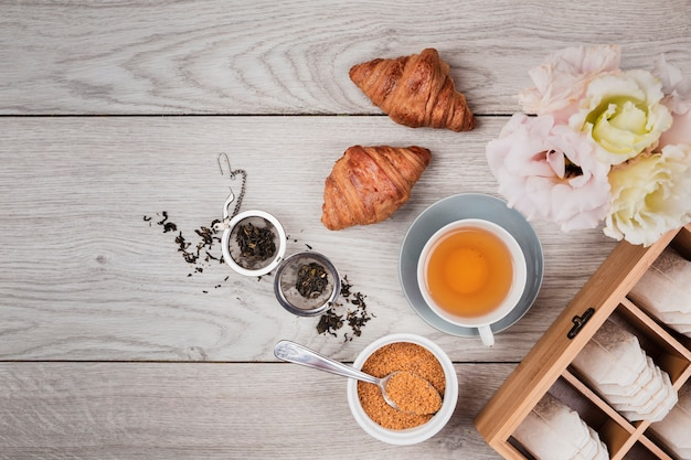 Tasty croissants on wooden background