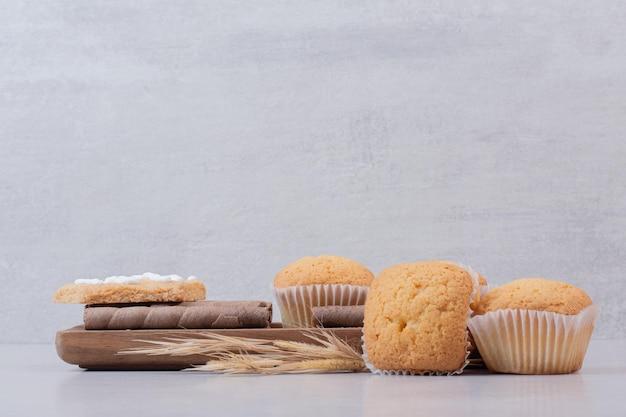 Tasty cupcakes on white table .