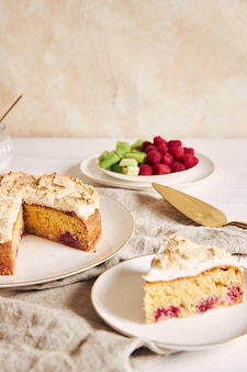 Tasty and delicious cake with baiser and  raspberries on a plate