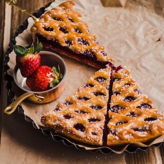 Tasty dessert serving on baking tin