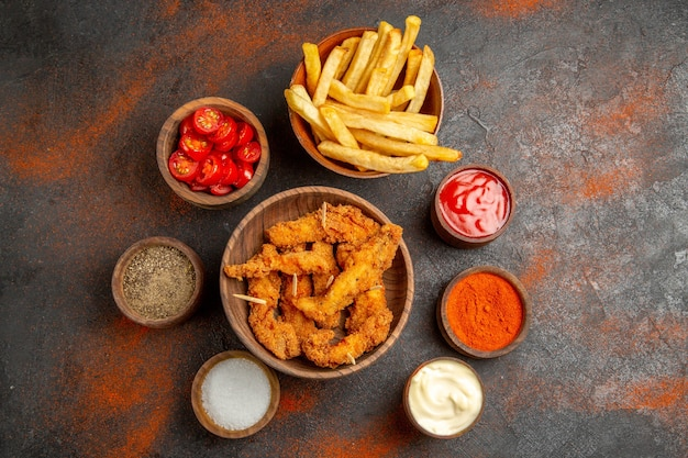 Tasty dinner with crispy fried chicken and potatoes