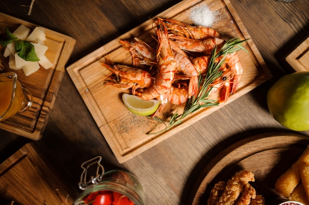 Tasty dish of large shrimps on a wooden table
