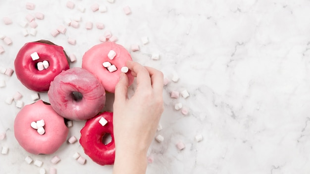 Tasty donuts with marsmallows