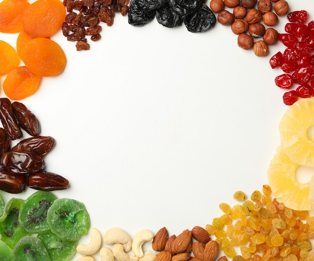 Tasty dried fruits on white, space for text