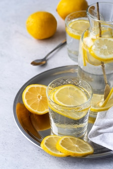 Tasty drink with lemon slices high angle