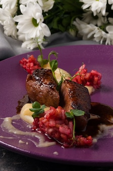 Tasty duck breast with strawberry tartare vertical frame