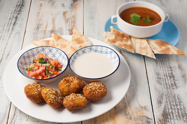 Tasty falafel with pita vegetable salad and soup traditional arabic cuisine
