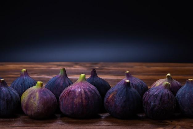 Tasty figs on a black background