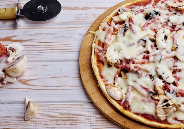 Tasty and flavorful pizza on the table. appetizing homemade pizza.