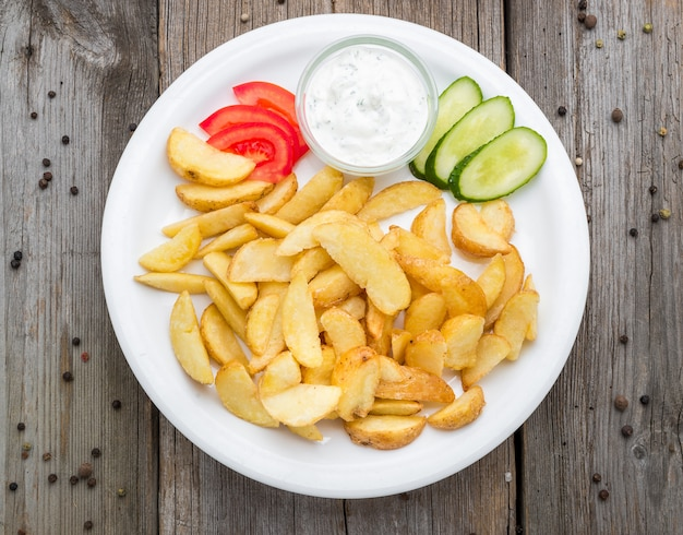 Tasty french fries on plate