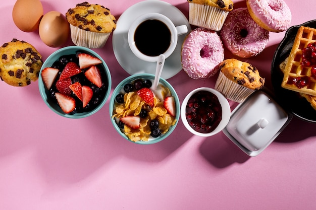 Tasty fresh breakfast food ingredients on pink bright background. ready to cook. home healthy food cooking concept.