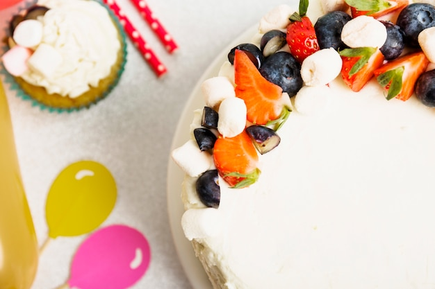 Tasty fresh cake with berries on table