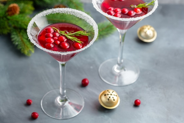 Tasty fresh christmas cocktail with cranberries served in glasses. closeup