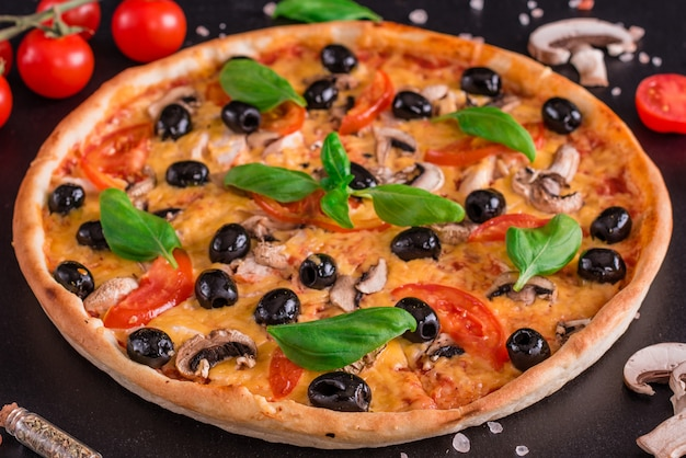 Tasty fresh hot pizza against a dark background
